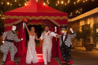 cj-lana-perry-and-miroslav-rusev-barnyashev-at-circus-theme-wedding-running-under-red-circus-tent