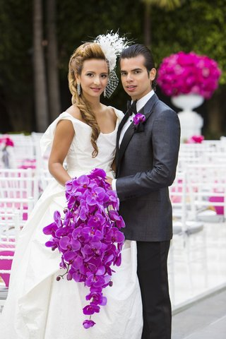 bride-in-net-blusher-veil-with-cascading-orchid-bouquet-and-groom