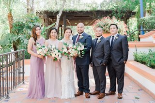 wedding-portrait-bride-and-groom-two-bridesmaids-two-groomsmen-mismatched-dresses-bouquets-courtyard