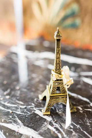 paris-eiffel-tower-with-ribbon-and-yellow-gold-wedding-rings-engagement-ring-mens-band