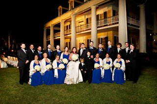 bridesmaids-in-floor-length-royal-blue-dresses-with-groomsmen-in-black-suits-at-louisiana-plantation