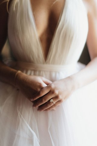 bride-in-tulle-wedding-dress-v-neck-solitaire-engagement-ring-bracelet