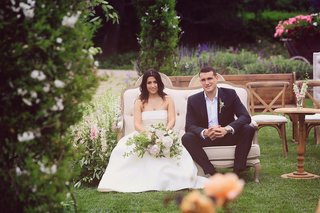 bride-in-monique-lhuillier-crop-top-wedding-dress-sits-with-groom-in-armani