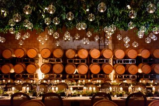 wine-barrel-room-wedding-venue-with-glass-orb-candlelight