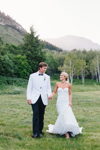 bride-in-strapless-inbal-dror-wedding-dress-with-groom-in-white-tuxedo-jacket-bow-tie-sundance-utah