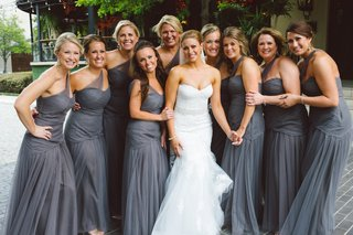bridesmaids-in-floor-length-one-shoulder-gowns