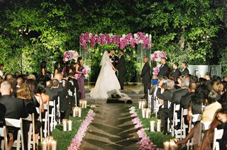 purple-wedding-flowers-at-outdoor-wedding-ceremony-and-on-lucite-gazebo-at-four-seasons