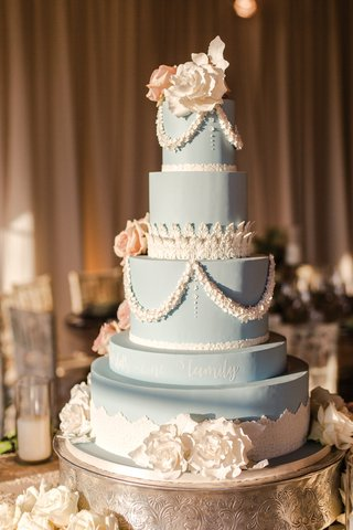 four-tier-wedgwood-blue-cake-with-lace-details-white-and-blush-sugar-flowers