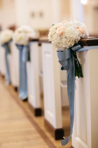 wedding-ceremony-church-pews-decorated-with-white-hydrangeas-pink-roses-and-blue-ribbon