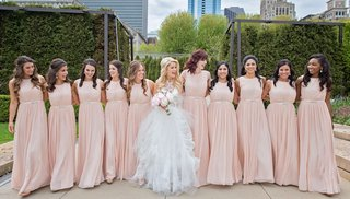 bride-in-middle-of-ten-bridesmaids-in-long-blush-light-pink-gowns