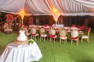 wedding-reception-acqualina-resort-and-spa-tent-reception-long-head-table-pink-red-flowers