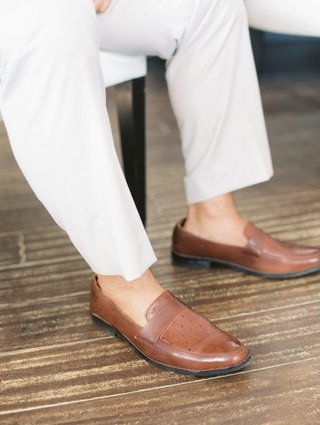 brown-leather-shoes-and-no-socks-on-groom-with-light-colored-pants