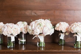 wedding-bouquets-in-glass-vases-pink-white-peonies-garden-roses-bride-bridesmaids