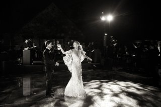 black-and-white-photo-of-magical-first-dance-wedding-reception-dance-floor-lighting