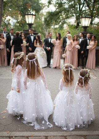 four-flower-girls-in-white-dresses-with-butterfly-designs-flower-crowns-ribbons-long-sleeve-lace