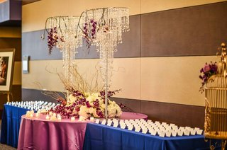 place-card-table-with-center-table-with-display-of-white-hydrangeas-purple-orchids-and-crystal