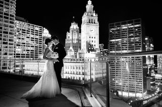 black-and-white-photo-of-bride-in-monique-lhuillier-wedding-dress-and-groom-with-chicago-skyline