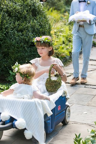 wedding-ceremony-outdoor-blue-wagon-flower-girls-flower-crown-lace-dress-moss-basket