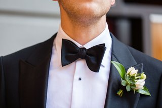 groom-in-tuxedo-and-bow-tie-with-succulent-white-flower-green-leaf-boutonniere