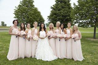 bride-in-oscar-de-la-renta-wedding-dress-with-bridesmaids-in-amsale-pink-dresses