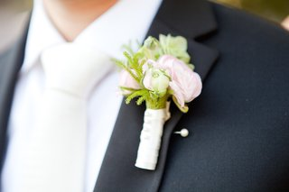 groom-in-a-black-by-vera-wang-suit-white-silk-tie-and-boutonniere-with-pink-white-green-flowers