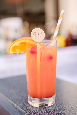 gold-and-white-striped-straws-drink-stirrers-signature-cocktail-with-orange-and-cherry