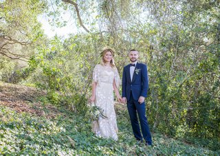 bohemian-wedding-bride-and-groom-stand-in-forest-on-a-hillside-in-santa-barbara-california