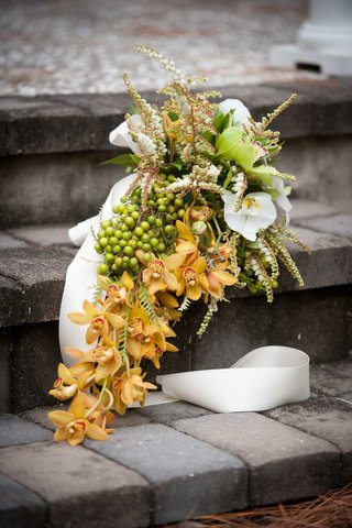 multicolor-orchid-bouquet-with-berries-and-foliage