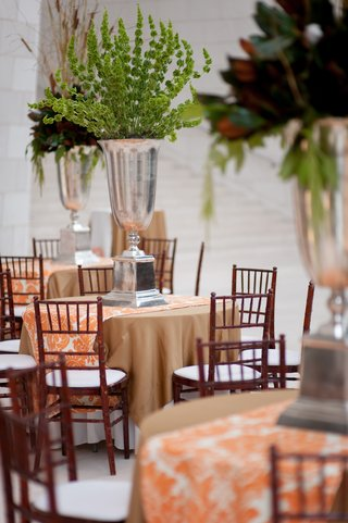 reception-tables-with-orange-runners-and-southern-centerpieces