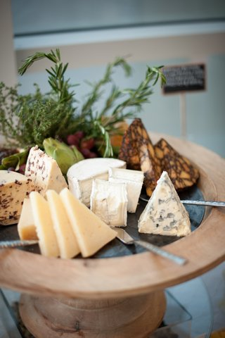 blue-cheese-brie-cheese-and-others-on-wood-stand