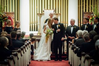 bride-and-groom-touch-foreheads-at-traditional-church-wedding