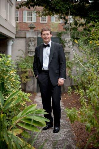 groom-in-savannah-georgia-wearing-tuxedo-at-wedding