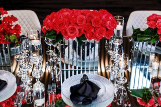bright-pink-roses-in-mirrored-boxes-on-mirrored-tables
