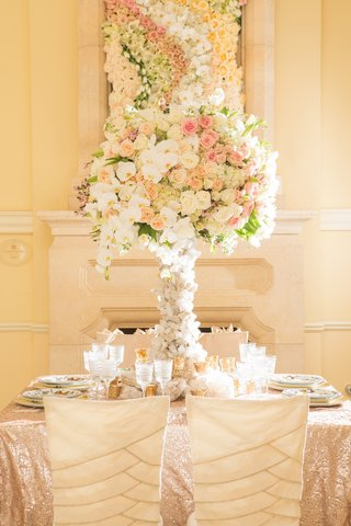 wedding-reception-with-chairs-covered-with-layered-sleeves-table-with-gold-sequined-tablecloth