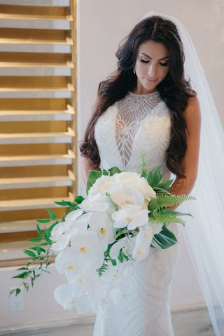 bridal-bouquet-with-white-phalaenopsis-orchids-ferns-tropical-leaves-greenery