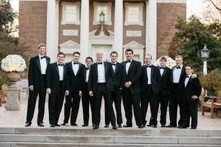 groom-and-groomsmen-in-front-of-perkins-chapel-in-tuxedos-with-bow-ties