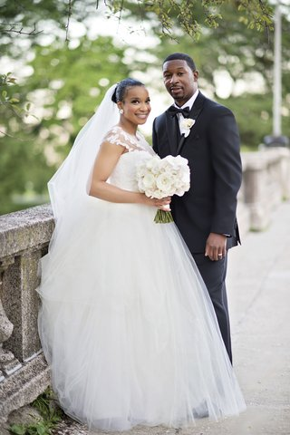 bride-in-legends-romona-keveza-gown-with-illusion-neckline-tulle-skirt-groom-in-jos-a-bank-tux