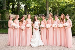 bride-in-pnina-tornai-wedding-dress-with-bridesmaids-in-long-blush-bridesmaid-dresses-bouquets