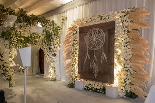 wedding-reception-dream-catcher-design-on-wood-photo-booth-backdrop-white-rose-pampas-grass-ballroom