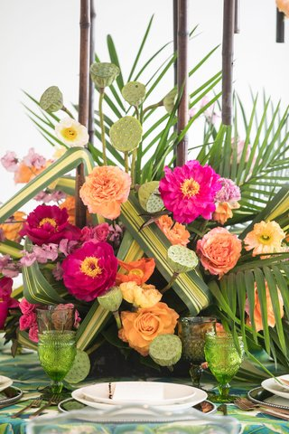tropical-wedding-inspiration-vibrant-pink-flowers-orange-flowers-palm-fronds