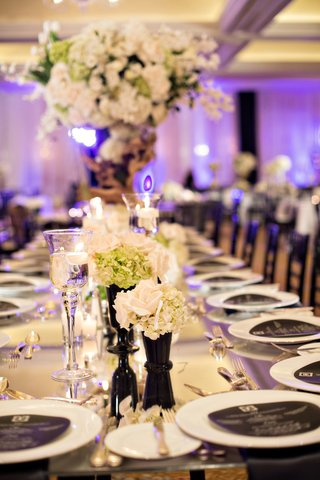 green-white-and-black-reception-decor-round-menus-purple-lighting