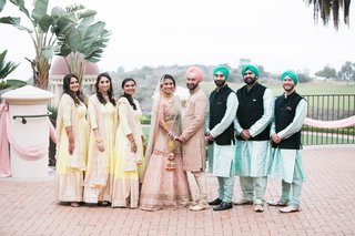 bridesmaids-in-yellow-bride-in-blush-sari-groomsmen-in-turquoise-sikh-ceremony