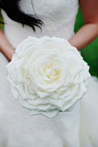 bride-holding-white-glamelia-composite-wedding-bouquet