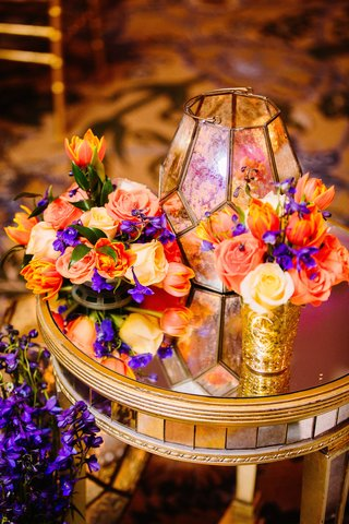 sangeet-decoration-with-bright-orange-purple-yellow-flowers-and-glass-lantern