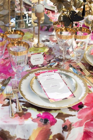 gold-leaf-china-charger-plates-wine-glasses-flatware-silverware-with-invitations-candles-pink-linen