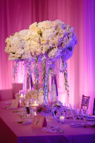 purple-pink-uplighting-centerpieces-with-roses-hydrangeas-mums-and-chrysanthemums