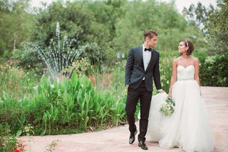 bride-in-a-strapless-anne-barge-ball-gown-with-sweetheart-neckline-beaded-belt-tulle-skirt-groom