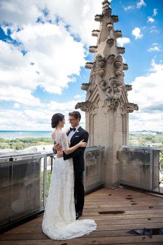 bride-in-lace-v-neck-carolina-herrera-groom-in-ralph-lauren-roof-of-chapel
