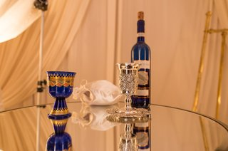 blue-and-gold-cup-and-wine-bottle-silver-kiddush-cup-jewish-wedding