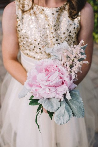 flower-girl-in-gold-and-white-dress-carries-pink-peony-lambs-ear-dusty-miller